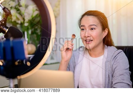 Asian Woman Blogger Or Vlogger Working Online For Beauty And Makeup. Social Media Influencer And Con