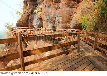 Retro Wooden Walk Way At The Rock Ciff  At Wat Pu Gon Buengkan Thailand