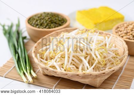 Fresh Mung Bean Sprouts In Bamboo Basket With Mung Bean Seeds And Tofu, Organic Vegetables And Food