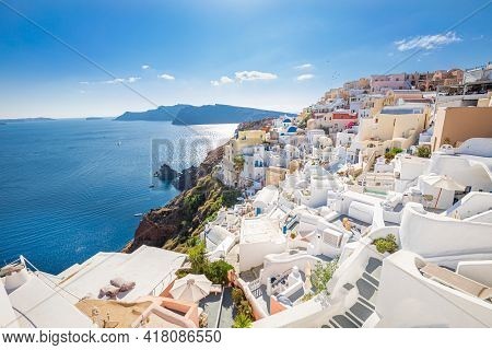 Famous View Of Oia Town Cityscape At Santorini Island In Greece. Traditional Blue Dome And White Hou