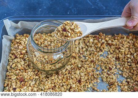 Freshly Baked Granola, Muesli From Oat Flakes, Varius Of Nuts, Honey, Pumpkin Seeds In Glass Jar. Ho