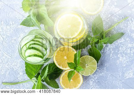 Fresh Cool Detox Water Drink With Cucumber And Lemon. Two Glass Of Lemonade With Basil And Mint Leav