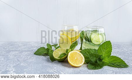 Fresh Cool Detox Water Drink With Cucumber And Lemon. Two Glass Of Lemonade With Mint. Concept Of Pr