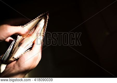 Leather Wallet Full Of Russian Money-5000 Bills, Five Thousand Rubles. A Man\'s Hand Holds An Open,