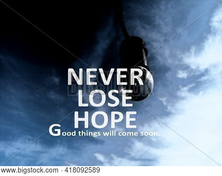 Inspirational Quote - Never Lose Hope. Good Things Will Come Soon. With Bulb Lamp On Blue And Dark S