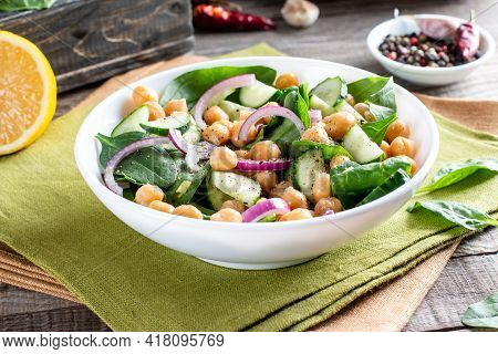 Salad Of Chickpeas, Spinach, Cucumbers, Onions And Greens In A Plate. Dietary Food. Vegan Salad.