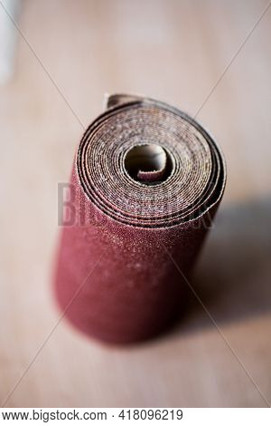 Sandpaper Roll On A Wooden Table