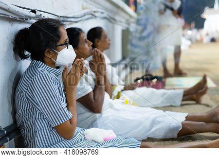 Anuradhapura, Sri Lanka - 03 30 2021: Buddhist Devotees Praying At The Ruwanwelimahasaya, Wearing A