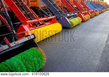 Transport For Cleaning City Streets From Dirt Is Getting Ready For Work. Machines With Brushes For R