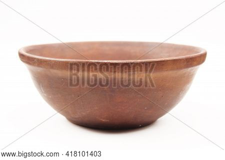 Rustic Old Traditional Kitchen Utensils In The Form Of A Clay Plate Or Bowl On A White Background. E