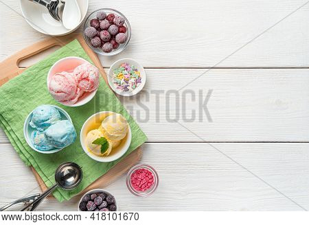 Mango, Raspberry And Blueberry Flavored Ice Cream On A Light Background With Space To Copy. A Refres