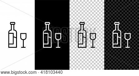 Set Line Wine Bottle With Glass Icon Isolated On Black And White Background. Vector