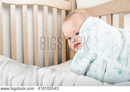 Funny Baby 8 Months Old On Bed In Morning. Sleep Of Baby In Crib, Falling Asleep On Its Own, Waking