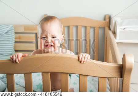 The Baby 8 Months Old Is Crying On Bed. Sleep Of A Baby In A Crib, Falling Asleep On Its Own, Waking