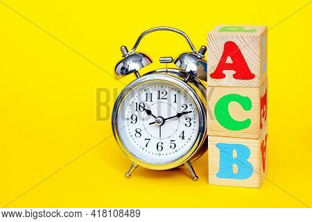 Dyslexia Concept. Abc - Acb - Not Consistently The First Letters Of The English Alphabet On Wooden T