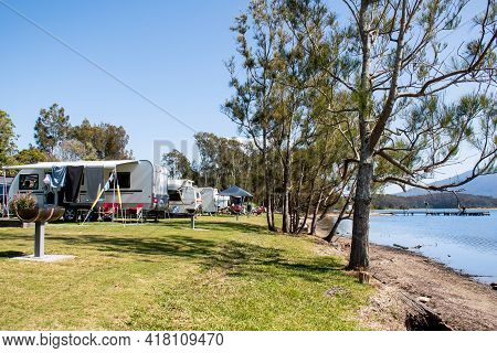 Rv Caravans Camping At The Caravan Park On A Peaceful Lake With Mountains On The Horizon. Camping Va
