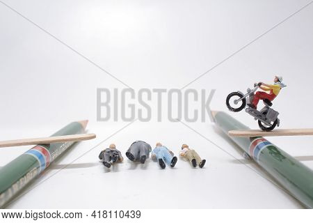 A Mini Figure Rider Freestyle Motocross, A Stunt Biker Make A Jump