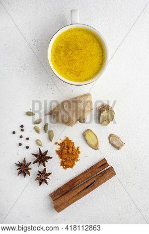 Ingredients For Turmeric Latte. Turmeric Powder, Curcuma Root, Cinnamon, Ginger, Badian Over Grey Ba
