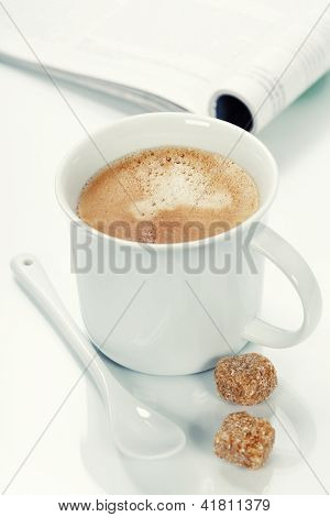 coffee and magazine on a table