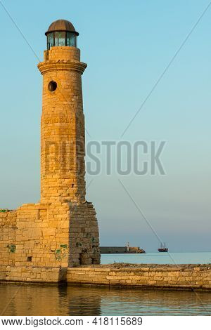 Historic Lighthouse At The Old Rethymnon Harbor, Crete