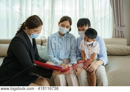 Asian Woman's Insurance Broker Is Offering Details Of Health Insurance Coverage For Covid-19 To Asia