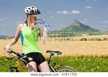 biker with bottle of water, Hazmburk, Ceske stredohori, Czech Republic