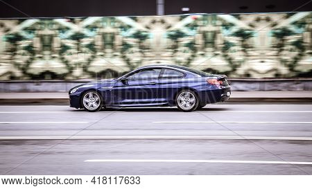 Moscow, Russia - April 2021: Bmw M6 F13 Coupe Riding On The Highway. Side View Of Shiny Blue Bmw 6 S
