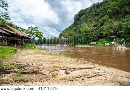 Scenery View Of Kok River From Chiang Rai Beach, A River Bank With Rocky Shores View. It's A Popular