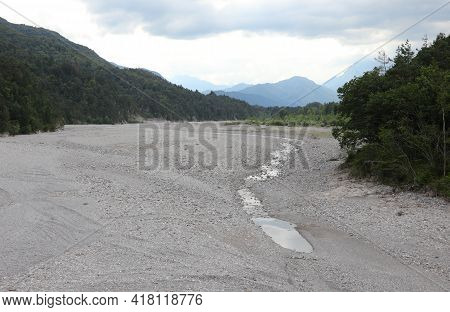 Dry Bed Of The River Called Tagliamento Is The Karst Phenomenon That Causes The Water To Go Undergro