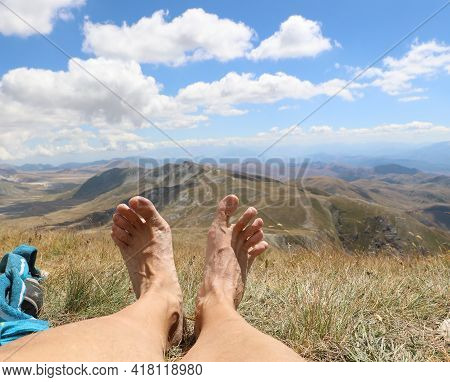 Well-deserved Rest After Hiking In The Mountains And Two Bare Feet With The Apennines In The Backgro