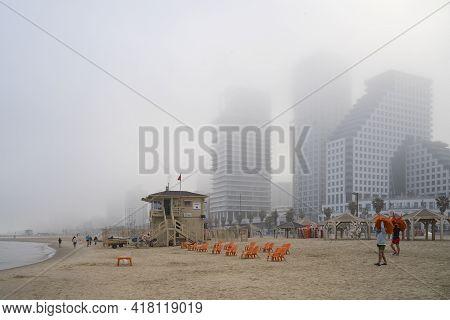Tel Aviv, Israel - April 16th, 2021: A Hazy Morning On The Beach Of Tel Aviv, Israel. The Staff Memb