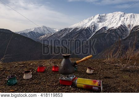 Tlarata. Russia. April 07, 2021. Still Life Of A Camping Set For Brewing Natural Coffee On The Backg