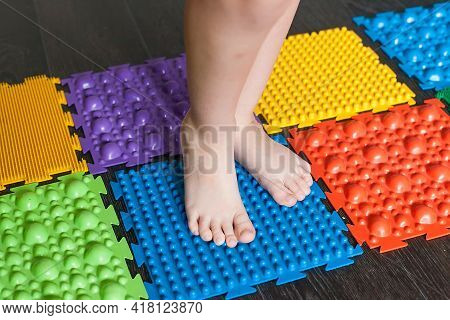 Orthopedic Massage Mat, Selective Focus, Blurred Background. Prevention Of Flat Feet For Adults And