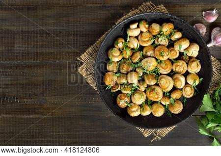 Delicious Fried Mushrooms In Frying Pan On Wooden Background With Copy Space. Top View, Flat Lay