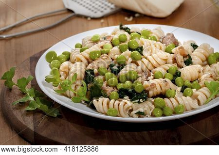 Fusilli With Spinach, Herbs, Fish, Cheese And Green Peas.