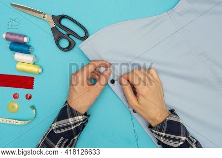 Tailor Sews. Mens Hands Are Sewing On A Button. Clothing Sewing And Repair. Creative Development. Le