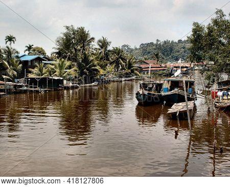 Fishing Village Scene In Bintulu River Sarawak Borneo