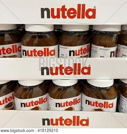 Bologna - Italy - April 21, 2021: Nutella Hazelnut Spread Jars In Shelf Of An Italian Supermarket. N