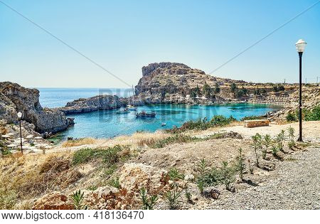 Panoramic View Of Saint Paul's Bay With Motorboats And People Swimming At Sunlight On Summer Day In