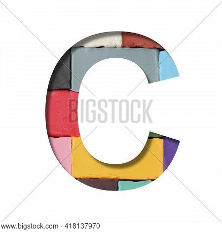 Multi-colored Plasticine Font. Letter C Cut Out Of Paper On A Background Of Pieces Of Colored Plasti