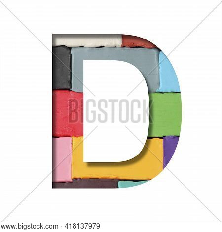Multi-colored Plasticine Font. Letter D Cut Out Of Paper On A Background Of Pieces Of Colored Plasti