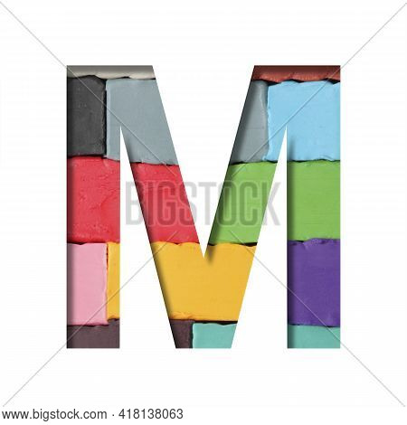 Multi-colored Plasticine Font. Letter M Cut Out Of Paper On A Background Of Pieces Of Colored Plasti