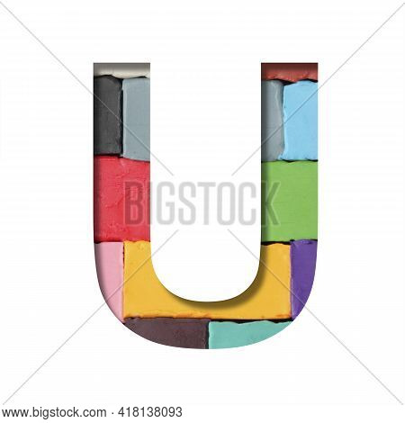 Multi-colored Plasticine Font. Letter U Cut Out Of Paper On A Background Of Pieces Of Colored Plasti