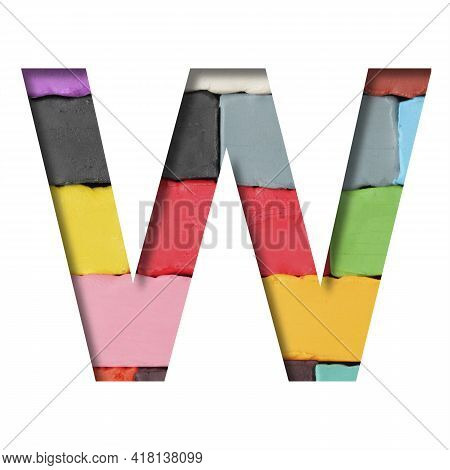 Multi-colored Plasticine Font. Letter W Cut Out Of Paper On A Background Of Pieces Of Colored Plasti