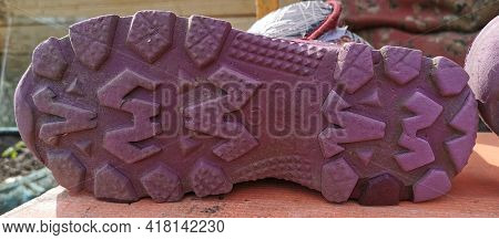Tread The Soles Of A Grey Rubber Boot On The Table