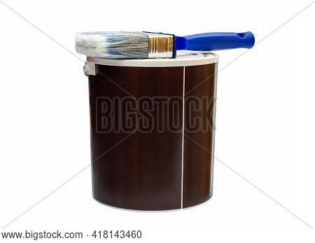 Paint Brush On Paint Bucket. Isolated On White Background.
