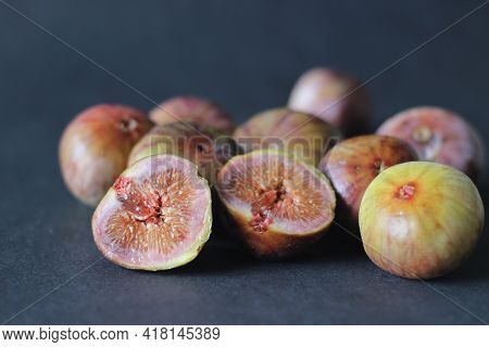 Ripe And Juicy Fresh Fig Whole And Halved.