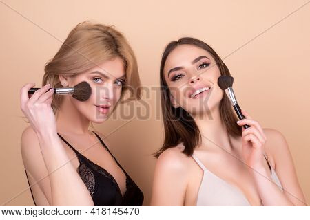 Beautiful Girls With Cosmetic Powder Brush For Make Up. Makeup. Make-up Applying For Perfect Skin.