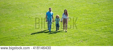 Young Family With Child Having Fun In Nature. Happiness And Harmony In Family Life. Banner Panorama