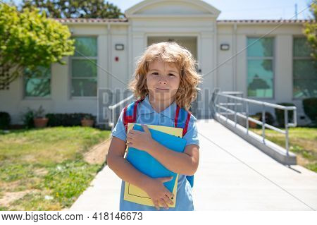 Back To School. Pupil Of Primary School On The Way To Study. First Grader. Beginning Of Lessons. Chi